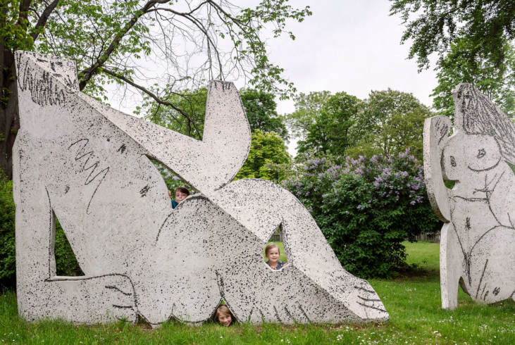 Children behind one of the sculptures in Picasso's group Déjeuner sur l'herbe (Luncheon on the Grass).